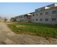 Amplasament industrial  - Fabrică de încălțăminte și teren intravilan aferent, în supraf 16.066mp
